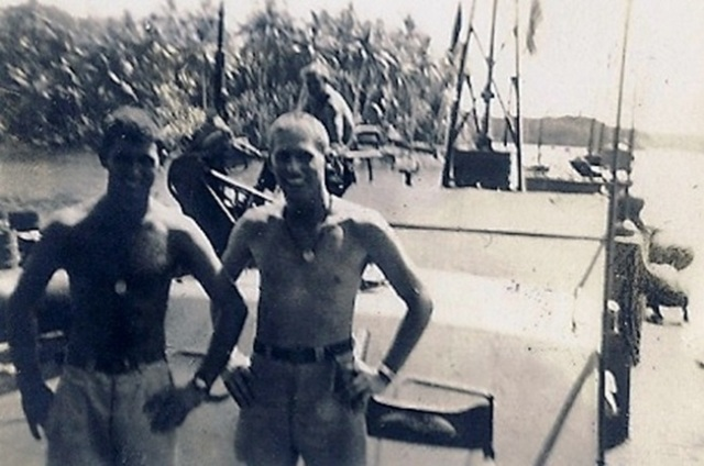 LTJG John F. Kennedy and LTJG John McElroy Rendova Island August 1943 PT-161 in the background
