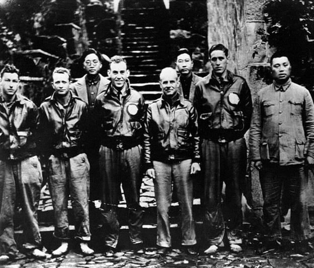 Lieutenant Colonel James H. Doolittle, USAAF, (center) with members of his flight crew and Chinese officials in China after the 18 April 1942 attack on Japan. (U.S. Army Air Forces Photograph, from the collections of the Naval Historical Center)