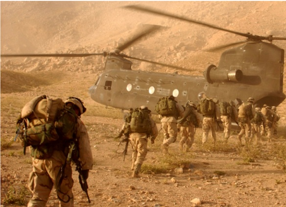 American infantry in Afghanistan, assigned to Company A, 2nd Battalion, 22nd Infantry Regiment, 10th Mountain Division, board a CH-47 Chinook helicopter for return to Kandahar Army Air Field on Sept. 4, 2003. The Soldiers were searching in Daychopan district, Afghanistan, for Taliban fighters and illegal weapons caches.