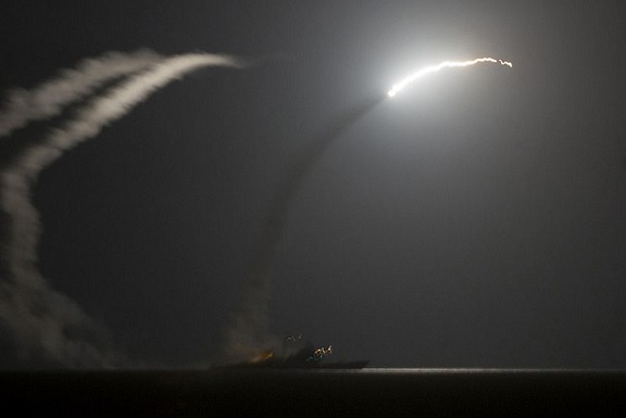 Tomahawk missile being fire from US destroyers USS Philippine Sea and USS Arleigh Burke at IS targets 23 September 2014