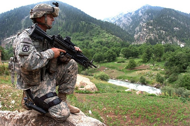 U.S. Army Spc. Jason Curtis Assigned to Charlie Company, 1st Battalion, 151st Infantry Regiment, provides security for members of a medical civil action project in Parun,Afghanistan, June 28, 2007.
