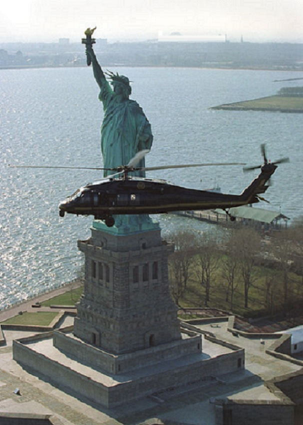 Helicopter flying in front of the Statue of Liberty, New York. Bureau of Immigration and Customs Enforcement office of Air and Marine Interdiction provides airspace security over New York City.