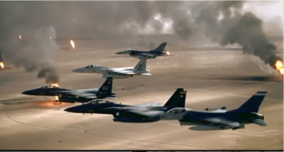 USAF aircraft of the 4th Fighter Wing (F-16, F-15C and F-15E) fly over Kuwaiti oil fires, set by the retreating Iraqi army during Operation Desert Storm in 1991.