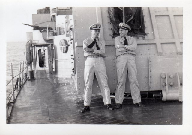 Captain John McElroy (right) and fellow officer onboard ship during USNR maneuvers