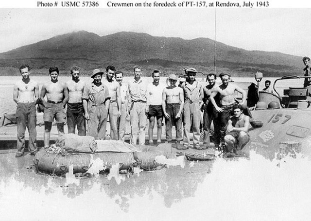 Commanding Officer, Ron 9 Squadron, Robert B. Kelly (7th from left) and PT-157 crew with Skipper Buddy Lebinow (eighth from left)