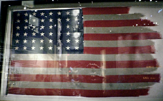 The flags from the first and second flag-raisings are conserved in the National Museum of the Marine Corps. second flag, pictured here, was damaged by the high winds at the peak of Suribachi (American flags during World War II had 48 stars, since Alaska and Hawaii were not yet U.S. states). Photo: Creative Commoms