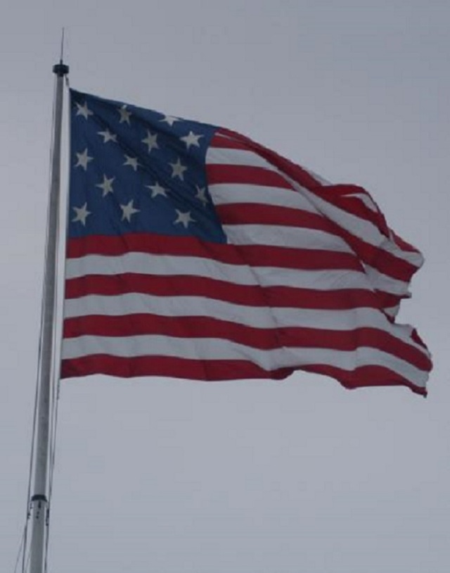 Replica of the Fort McHenry Flag, Flown in the 1814 Bombardment by the British, currently flying over Fort McHenry