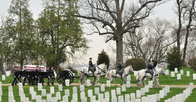 The Old Guard transports a flag-draped casket in full military honors at Arlington National Cemetery Army Photo