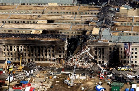 Aerial view of the Pentagon in Washington, D.C. as emergency crews respond to the destruction caused when a high-jacked commercial jetliner crashed into the southwest corner of the building, during the 9/11 terrorists' attacks.