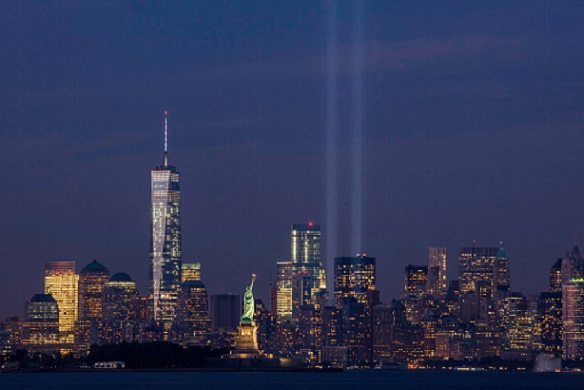 The Tribute in Light on September 11, 2014, on the thirteenth anniversary of the attacks, seen from Bayonne, New Jersey. The tallest building in the picture is the new One World Trade Center. Image by Anthony Quintano