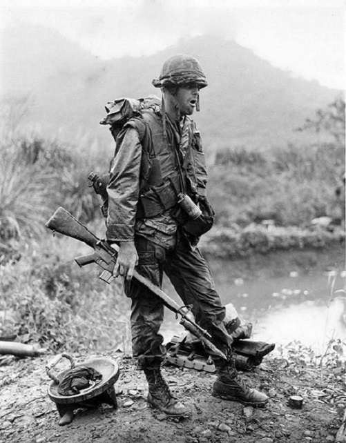 Pvt R Jones of the 2nd battalion, 7th marines takes a standing break during operation Pitt 12 miles north of Da Nang